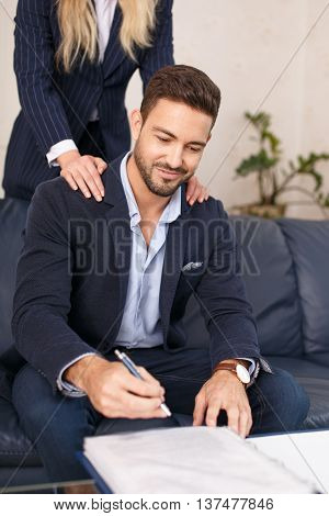 Secretary seduce young successful CEO in office put hands on shoulder