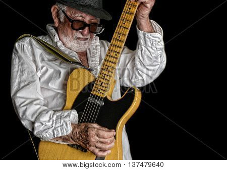 June 21 2016 Los Angeles, California Nice active Image Of a Elderly Rock Blues guitar player during a solo on a relic Fender Guitar