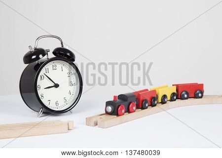 broken train line, clock in background to illustrate delays.
