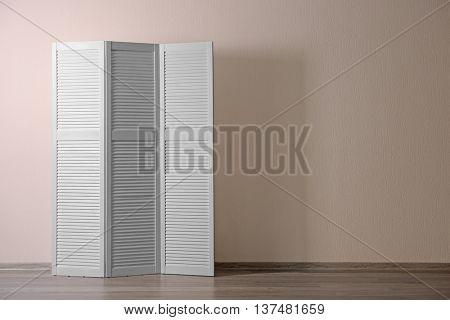 White folding screen in room