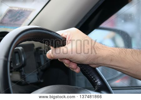 A man frequently test drive on highway