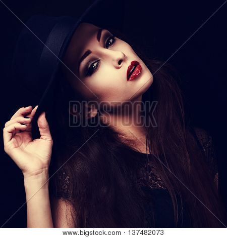 Beautiful Seductive Bright Makeup Lady With Red Hot Lips Posing In Hat On Black Background. Closeup