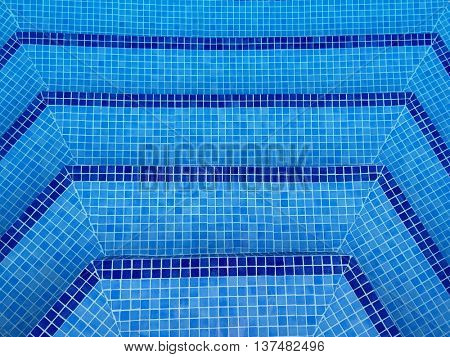 Corner Roman steps in a tiled swimming pool