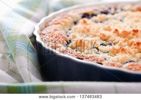 Detail Of Fresh Blueberry Pie In Blue Baking Dish