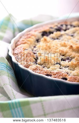 Detail Of Fresh Blueberry Pie In Blue Baking Dish On Towel