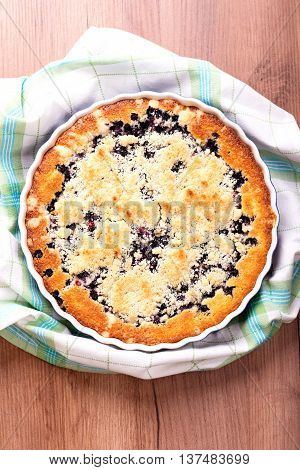 Top View On Blueberry Pie In A Baking Dish With A Towel Around