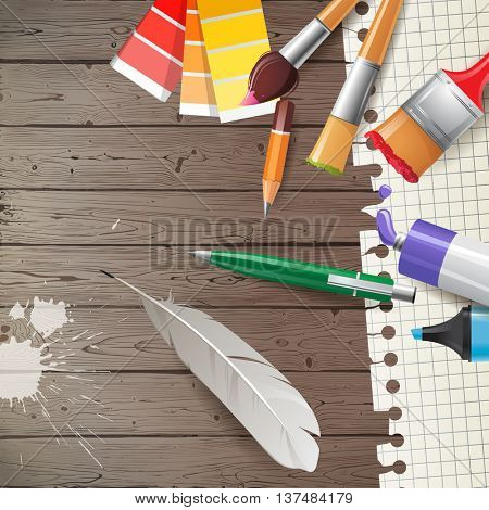 Painter's tools over wooden background
