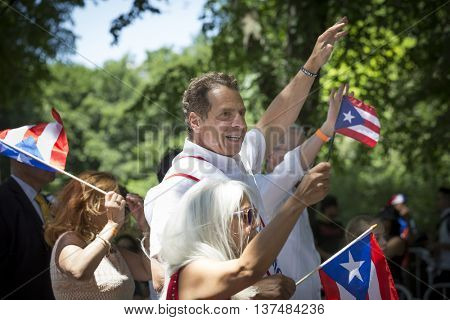 NEW YORK - JUNE 12 2016: New York Governor Andrew Cuomo marches in the 59th annual National Puerto Rican Day Parade on 5th Avenue in New York City on June 12 2016.