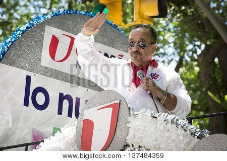 NEW YORK - JUNE 12 2016: Participants in the 59th annual National Puerto Rican Day Parade wave to the crowd from the Univision float on 5th Avenue in New York City on June 12 2016.
