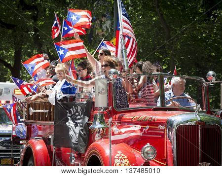 NEW YORK - JUNE 12 2016: Members of the FDNY march in the 59th annual National Puerto Rican Day Parade on 5th Avenue in New York City on June 12 2016.