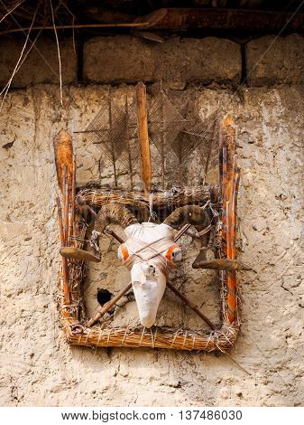 Traditional animist spirit catcher made from fabric-covered goat skull in Mustang, Nepal