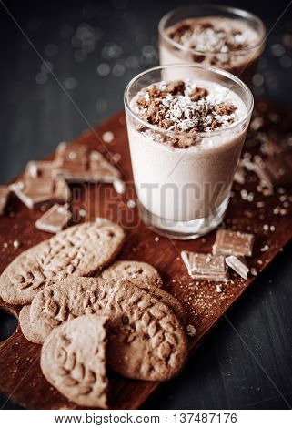 Cup with hot chocolate and chocolate chip cookies. Sweet chocolate dessert