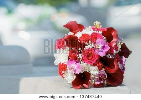 beautiful wedding bouquet of orchids,red Calla lilies and roses