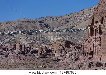 Ruin of Moghar Annassara (Christian Tombs ) in Petra and Uum Sayhoun village at background Jordan