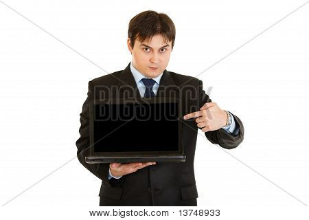 Modern businessman pointing finger on laptops blank screen isolated on white
