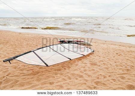 View of storm seascape. Windsurf board. Water sport