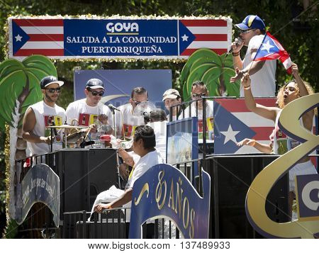 NEW YORK - JUNE 12 2016: Musicians perform from on top of the Goya float during the 59th annual National Puerto Rican Day Parade on 5th Avenue in New York City on June 12 2016.