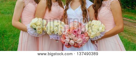 Pink Bridesmaid Posies Bride and bouquet of roses