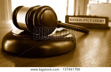 Judge's legal gavel in front of Bankruptcy Court nameplate