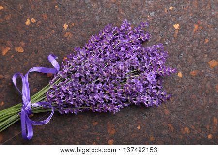 Bunch of lavender on the cork dark background.