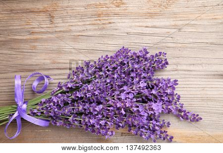 Bunch of lavender on a natural wooden background.
