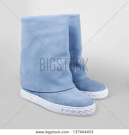 Female Blue Boots Over White