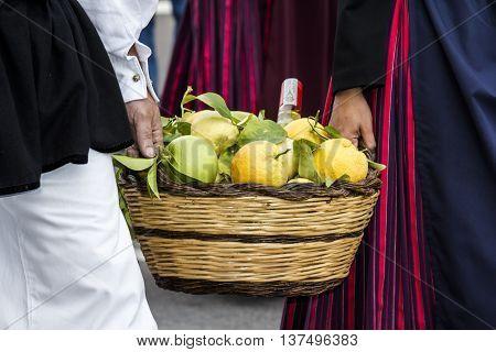 SELARGIUS, ITALY - September 13, 2015: Former marriage Selargino - Sardinia - basket of citrus fruits brought by two guys in traditional Sardinian costume