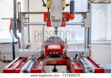 Close-up Of Industrial Metal Drilling Machinery. Factory Tools A