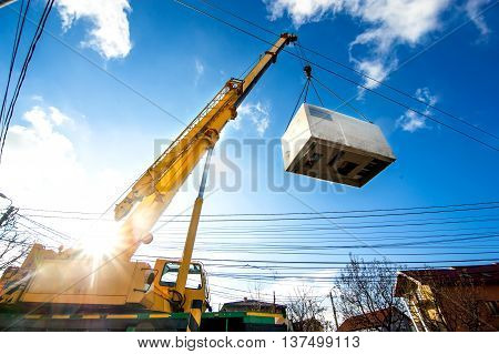 Mobile Crane Operating By Lifting And Moving An Heavy Electric G