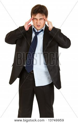 Young businessman with headache holding hands at head isolated on white