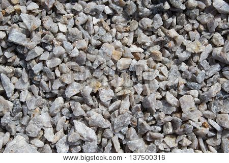 Texture the old crushed stone gray with yellow holes