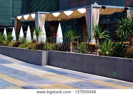 Outdoor gazebo taken in a courtyard garden with drought tolerant plants