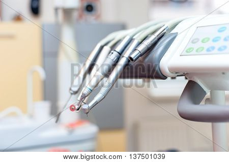Dental Tools On Dentist Chair With Medical Equipment And New Tec