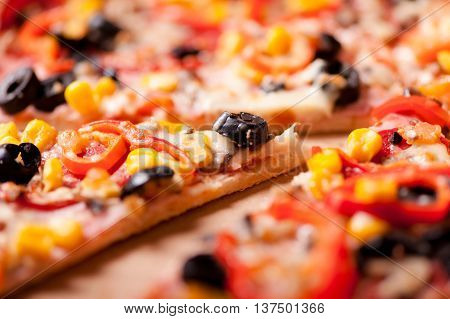 Close-up Of Slice Of Dinner Pizza With Ham, Olives, Mozzarella,