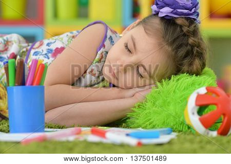 Cute  student girl sleeping  at art class
