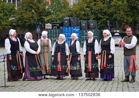 OSLO NORWAY - SEPT 20: Unidentified musicians garbed in period costumes performing on the square on Sept 20 2014 in Oslo Norway