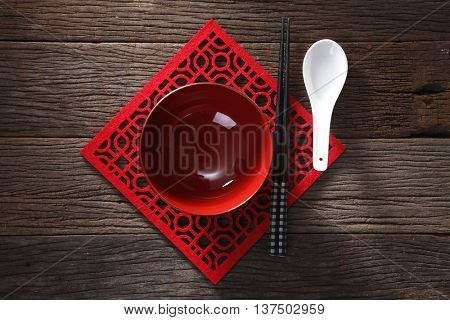 top view Chopsticks and bowl for rice on wooden background