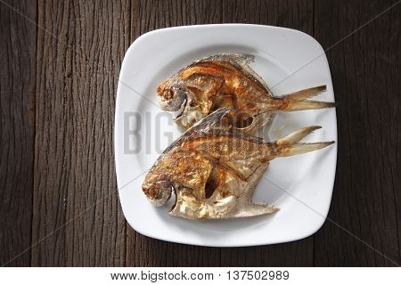 deep fried two small pomfret