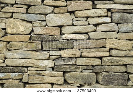 Old stone wall closeup in sunny day