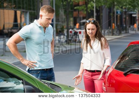 Worried Young People Looking At Car Collision