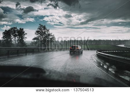 Drive Car In Rain On Curve Asphalt Wet Road
