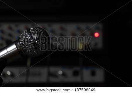 Microphone in studio on a background of the equipment