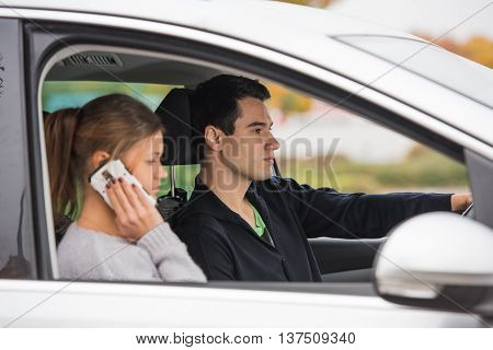 Young Couple In A Car