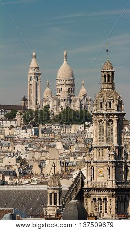 The famous Sacre Coeur basilica and Catholic Saint Trinity church Paris France.