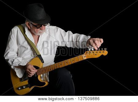 June 21,2016 Los Angeles California Guitar man tuning Up his guitar