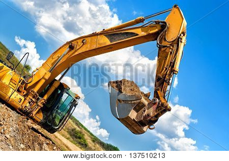 Heavy Duty, Industrial Excavator Moving Soil And Sand On Road Co