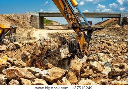 Dumper Truck Loading Rocks And Sand On Construction Site