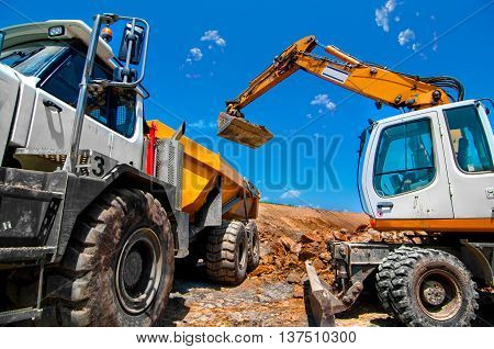 Big, Industrial Excavator On New Construction Site Loading A Dum