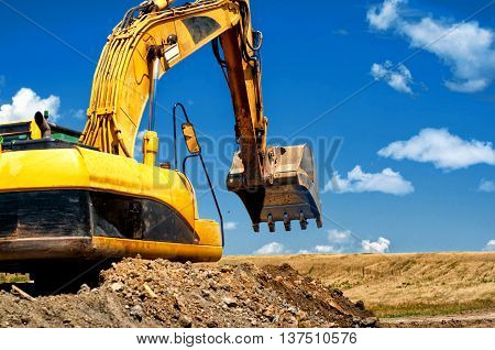 Yellow, Heavy Duty Excavator Moving Soil And Sand On Road Constr
