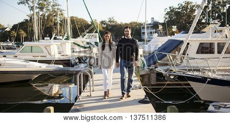 Young couple leaving from yacht